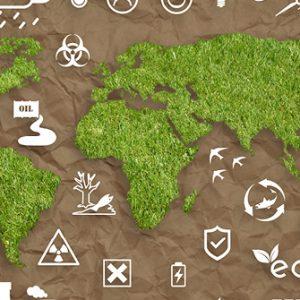 Weltkarte aus Gras mit Symbolen